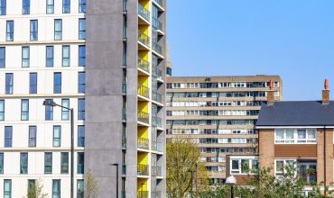 Modern flats in contrast to old council housing blocks in London